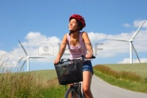 5106813-woman-relaxing-and-enjoying-the-sun-on-a-bike-trip-in-the-countryside-of-jutland-denmark-windmill-in